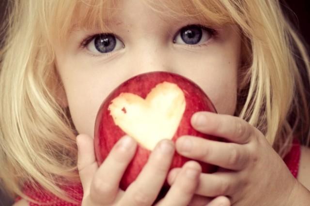 Food Bank - girl eats apple